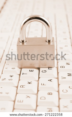 Security concept, padlock on white computer keyboard  - stock photo