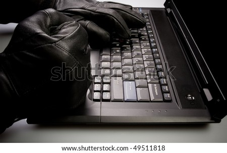 Security concept with mad hacker working on laptop at night, internet crime - stock photo