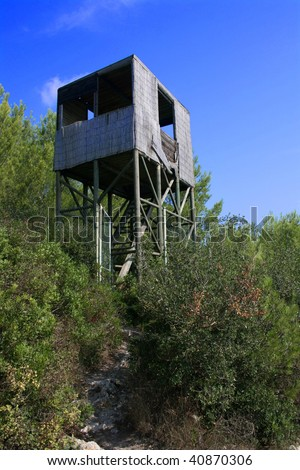 security control fire tower on a forest - stock photo