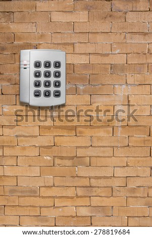 Security entrance touch pad on  brick wall - stock photo
