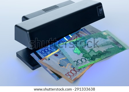 Security features on banknote in UV light protection - stock photo