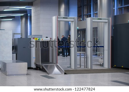 Security gates with metal detectors and scanners at entrance of airport - stock photo