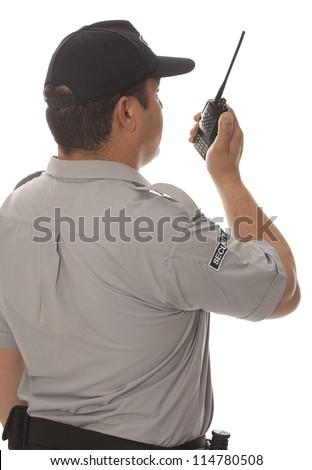 Security guard hand holding cb walkie-talkie radio - stock photo