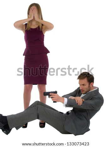 security guard shoots from the gun protects the woman isolated on a white background