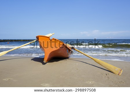 Security life boat at the sea beach in Kolobrzeg in Poland - stock photo