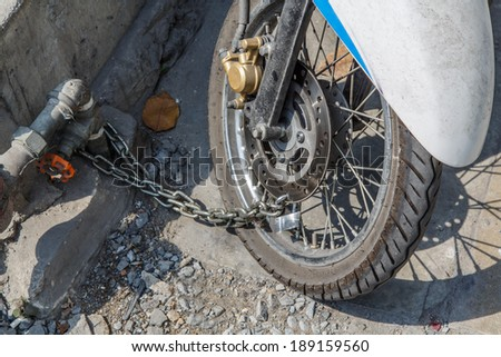 Security lock blocking the motorcycle wheel