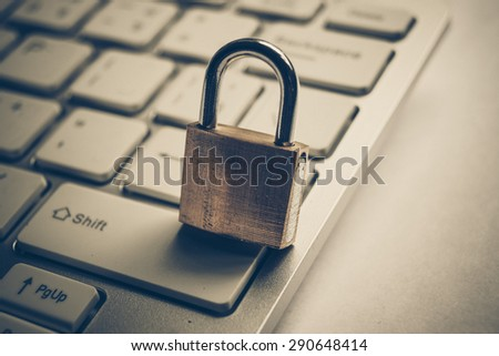 security lock on black computer keyboard - computer security concept - stock photo