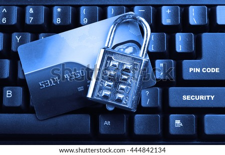security lock on credit cards with computer keyboard. Selective focus, soft focus and shallow depth of fields - DOF