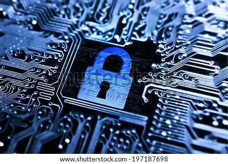 security lock symbol on computer circuit board - stock photo