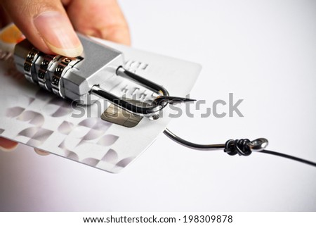 security lock with password and fish hooks on credit cards - phishing protection concept - stock photo