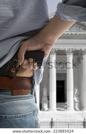 Security man holding gun against an courthouse background  - stock photo