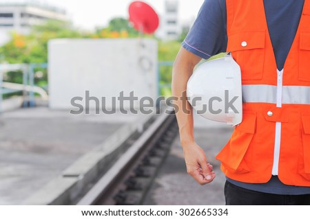 security of the person and the background for the railroad. - stock photo