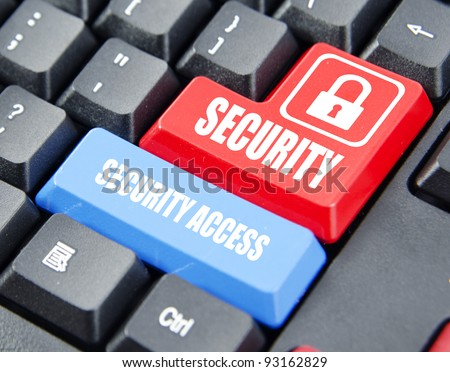Security on red keyboard button and security access on blue keyboard button. Concept on computer keyboard. - stock photo