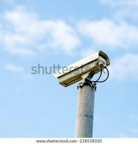 Security or cctv camera on blue sky background - stock photo