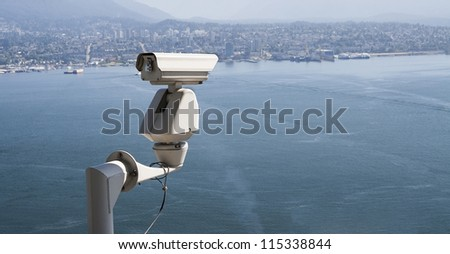 Security surveillance camera placed outdoor. - stock photo