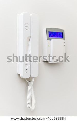 Security system panel with blue screen - stock photo