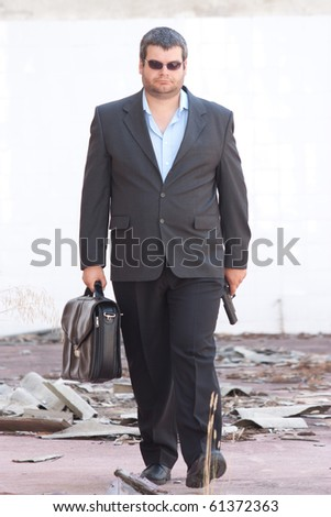 Security transporter with a leather case and a pistol - stock photo