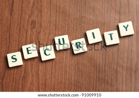 Security word made by letter pieces - stock photo