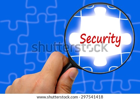 Security word. Magnifier and puzzles. - stock photo