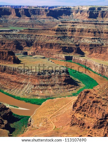 Sedimentary Rock Layering Cleanly Carved By The Ruddy Colorado River At Dead Horse Point State Park Near Moab, Utah, USA - stock photo