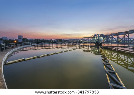 sedimentation basin, sewage flowing through large tanks - stock photo