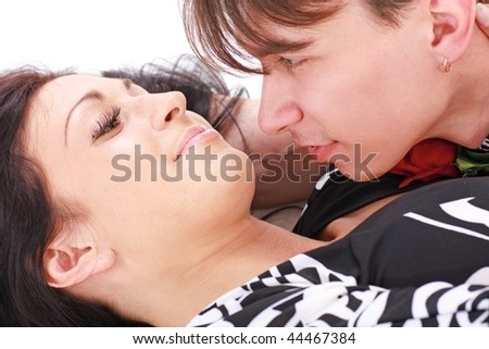 Seduction. Intimate couple close up on a white background. - stock photo