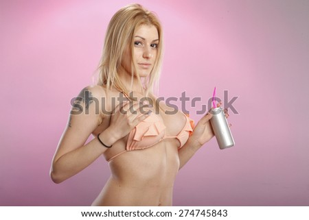 Seductive blond and beverage can