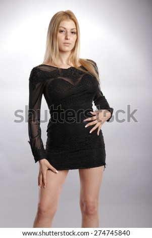 Seductive blond in creative black dress