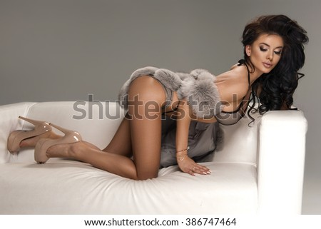 Seductive brunette beauty posing in studio  - stock photo