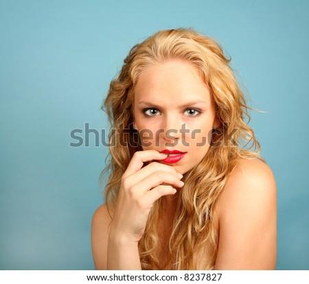 Seductive Caucasian Female on Blue Background - stock photo