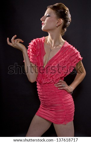 "Seductive Gesture.  side view of a woman  with a seductive, ""come hither"" gesture."
