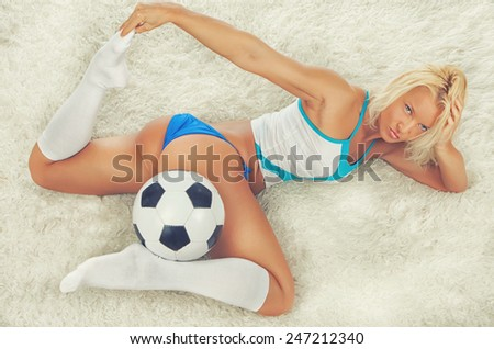 Seductive girl's posing with a ball on furs showing her butt - stock photo