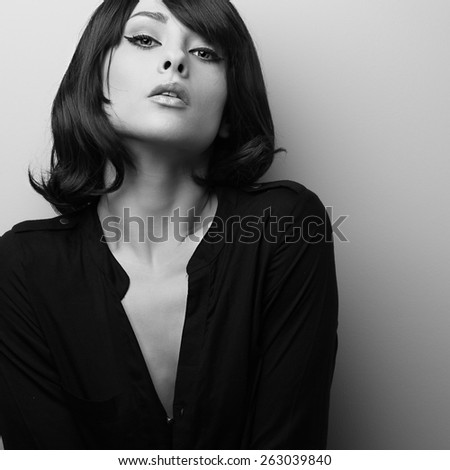 Seductive graceful female model with short hair style. Black and white portrait - stock photo