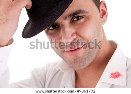 seductive man greeting with his hat, the shirt with lipstick mark - stock photo