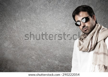 Seductive man with sunglasses and scarf. Vertical image.