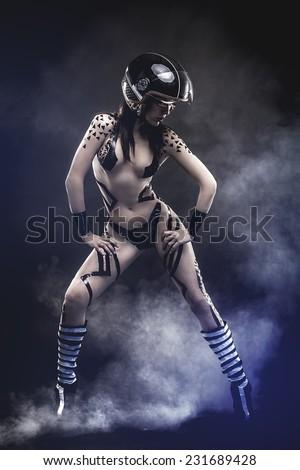 seductive power  beautiful woman with bike helmet, naked and black strips - stock photo