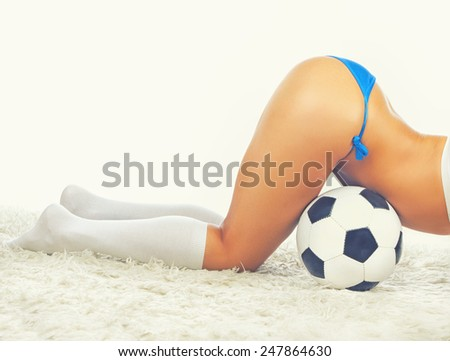 Seductive sexy girl on the fur with a ball - stock photo