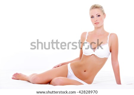 Seductive sexy white lingerie on the beautiful young woman with perfect health body - stock photo