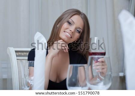 Seductive slim woman smiling at camera, close-up - stock photo