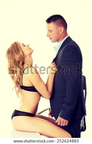 Seductive woman and man - office romance concept.