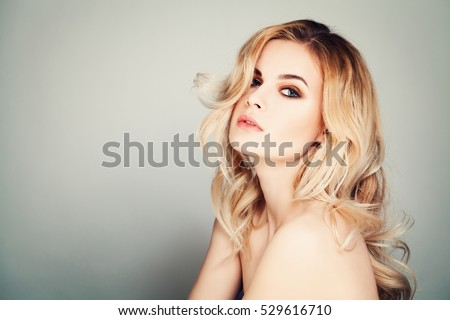 Seductive Woman. Cute Girl with Makeup and Blonde Permed Hairstyle