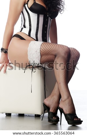 seductive woman in lingerie sitting on white background studio - stock photo