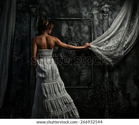 Seductive woman in white dress. - stock photo
