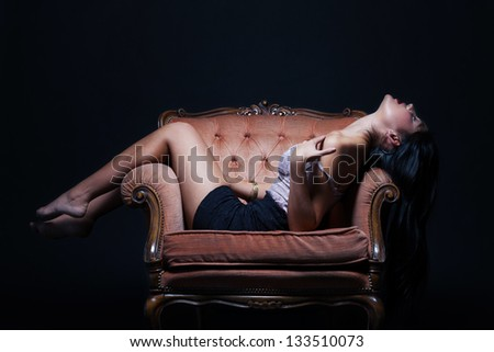 Seductive woman on a throne of pleasure