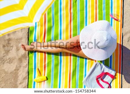 seductive woman taking sunbathe on beach - stock photo