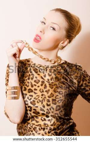 Seductive young provocative girl in leopard print showing her tongue - stock photo