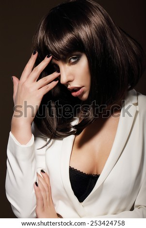 Seductive Young Woman with Dark Hair - stock photo