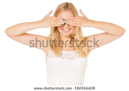 See no evil - portrait of young woman isolated on white background - stock photo