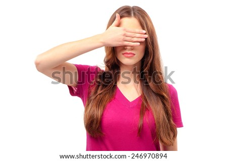 See nothing. Beautiful young long hair woman standing against white background and covering eyes with hand - stock photo