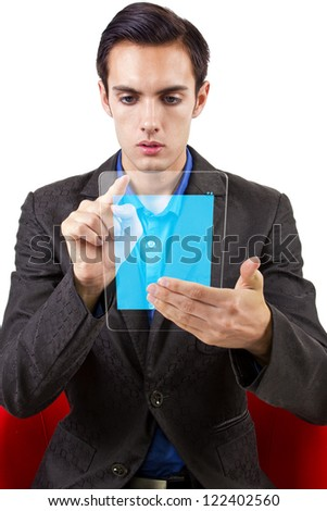 See through modern electronic tablet held by young Caucasian male. - stock photo